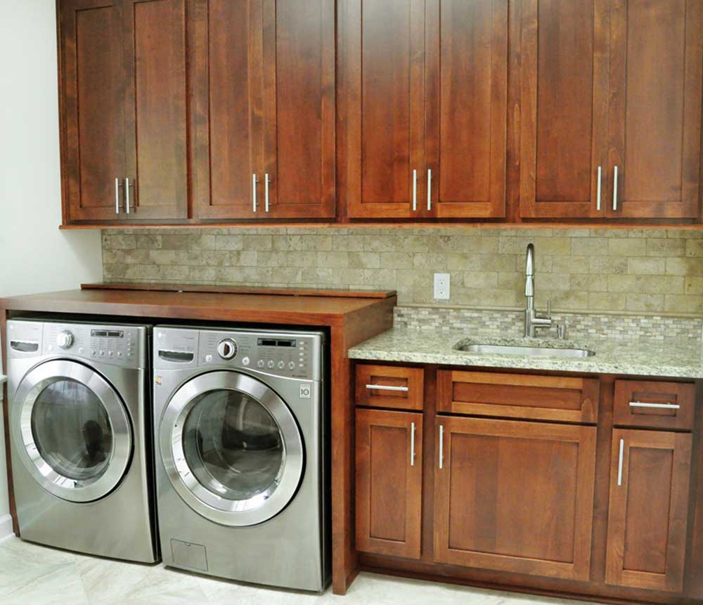 Basement Renovation With Bar and Laundry Room